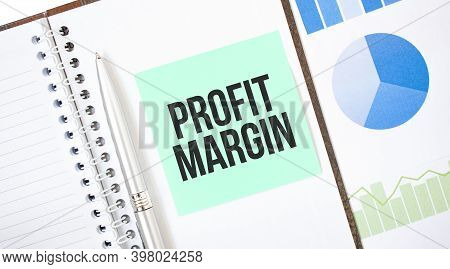 Green Card On The White Notepad. Text Profit Margin. Business Concept
