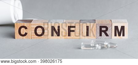 Confirm Is A Word Written In Black Letters On Wooden Cubes