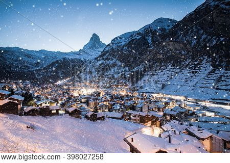 snowing in Zermatt traditional Swiss ski resort under the Matterhorn