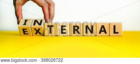 External Or Internal Symbol. Male Hand Flips Wooden Cubes And Changes The Word 'external' To 'intern