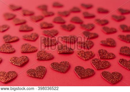 A Texture Formed With Small Red Hearts On A Red Background