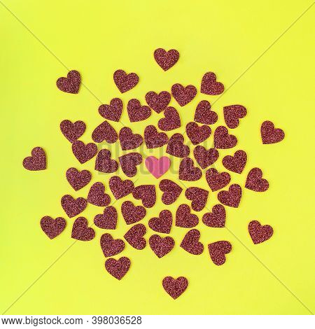 A Texture Formed With Small Red Hearts On A Yellow Background