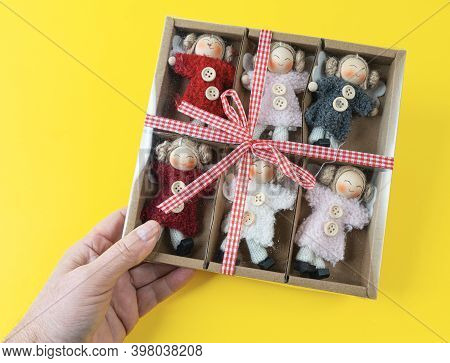 A Gift Box With Some Small Handcrafted Dolls