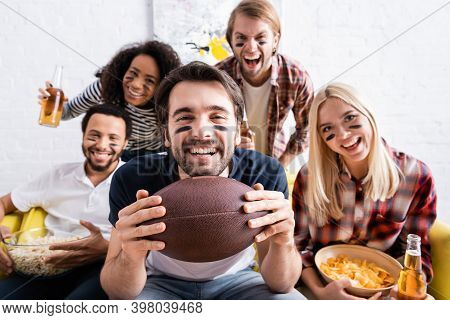 Excited Multiethnic Sports Fans Screaming While Watching American Football Championship