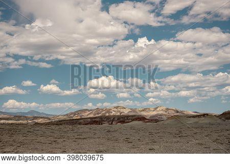 Distant Bentonite Hills In Capitol Reef National Park