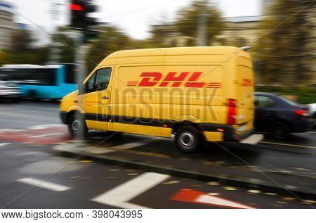 Bucharest, Romania - November 18, 2020 An Yellow Dhl Delivery Speeding Through The Traffic In Buchar