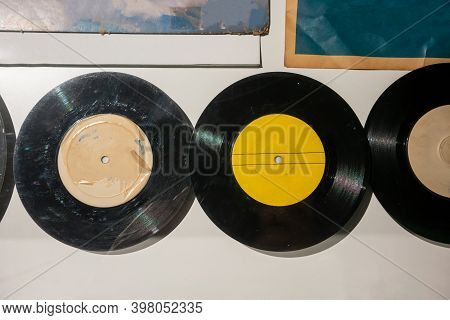 Old Vinyl Records Against White Background. Vintage Retro Concept.