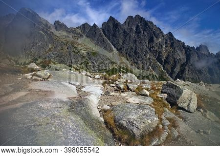 Velka Studena Dolina, High Tatras - Stones By The Tourist Trail With The Background Of Tatra Peaks D