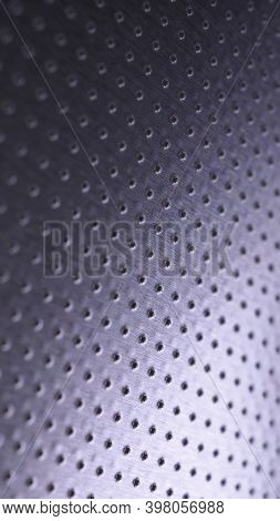 Dark Metal Mobile Wallpaper. Perforated Aluminum Surface With Many Holes. Tinted Violet Or Purple In