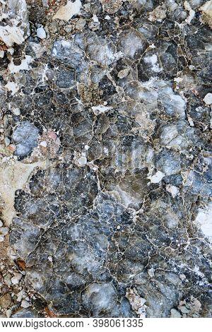 Diverse Colored Quartz Rock In Cut Of The Earth. Deposits Of Gray, White, Orange Quartz. Untreated S