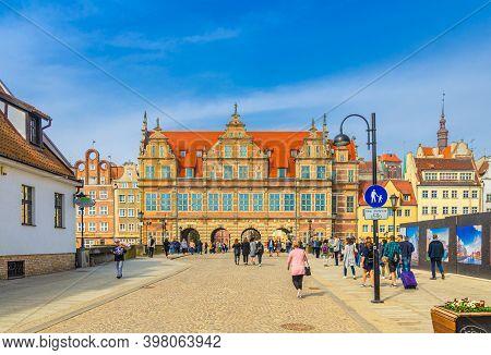 Gdansk, Poland, April 15, 2018: People Tourists Walking Down Pedestrian Street Across Bridge Over Mo
