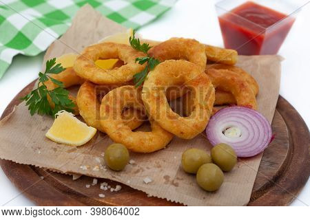 Deep Fried Squid Or Fish Rings Appetizer. Breaded Squid Or Fish Rings With Lemon,  Olives And Ketchu