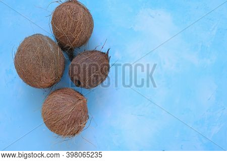 Coconuts Set Close-up On A Light Blue Background.fresh Coconut Group.raw Materials For Food And Cosm