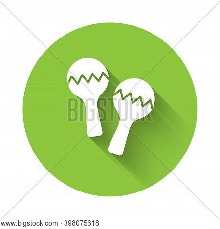 White Maracas Icon Isolated With Long Shadow. Music Maracas Instrument Mexico. Green Circle Button.