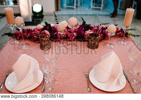 The Table Is Serviced For Two Newlyweds. Stands Decorated Cutlery, Composition Of Violet, Purple, Pi