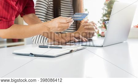 Online Payment. Happy Asian Woman Holding Credit Card And Using Tablet For Online Shopping With Chri