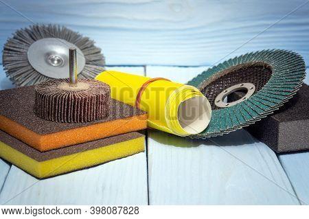 Set Abrasive Tools And Sandpaper Different Colors On Vintage Wooden Boards
