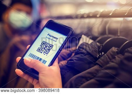 Selective Focus To Payment Qr Code Tag On Smartphone With Blurry Many Clothes In The Store To Accept