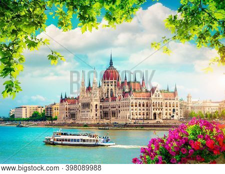 Flowers And Leaves Near Parliament In Budapest At Sunset, Hungary
