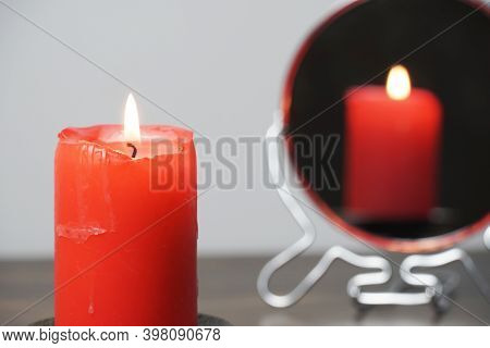 Concept Photo Of A Lighted Candle That Is Reflected In The Mirror.christmas Divination And Spiritual