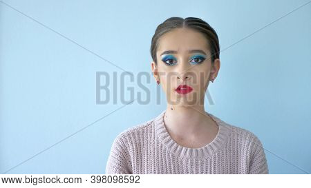Portrait Of A Beautiful Girl Model With Bright Makeup. Emotion Of Arrogance