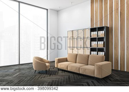 Beige Sofa In Office Room With Shelf With Lockers, White And Wooden Wall And Dark Parquet Floor. Sof