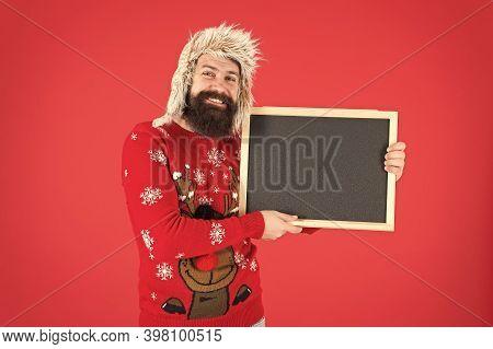 December Holidays. Happy Hipster Hold Empty Blackboard. December School Activities. Winter Holidays.
