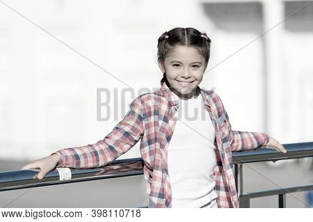 Childhood Activities That Will Never Get Dull. Happy Little Child Smiling In Casual Plaid Style For