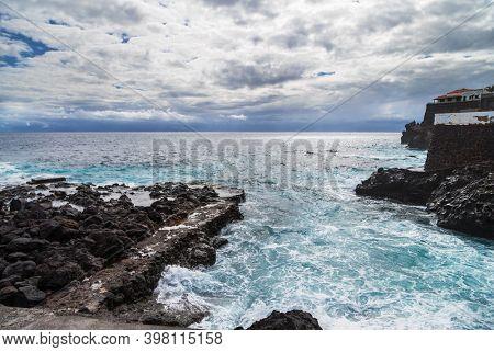 Rocks beach beach in cloudy gloomy weather. Tenerife island. Spain