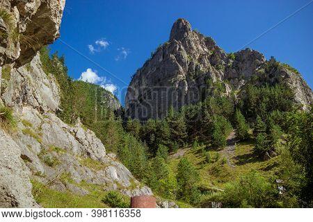 The Mountain Rock Below The Trees In Sunny Day. Romanian Mountain Near Bicaz Gorge. Carpathian Mount
