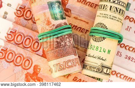 American Dollars And Russian Rubles Rolled Up In A Tube. American Sanctions. Money Background. Selec