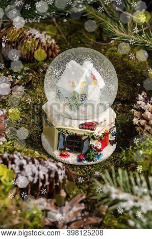 Cute Christmas Toy, A Snow Globe With A House And A Christmas Tree Inside. Christmas Gift Idea