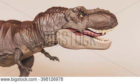 Tyrannosaurus Dinosaur Toy Figure On Light Background