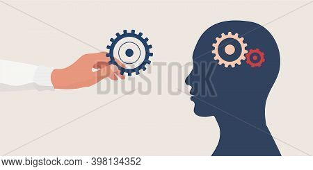 Mental Health Concept.therapist Or Doctor Hand Holding A Gear For As A Symbol Of Mental Care.head Wi
