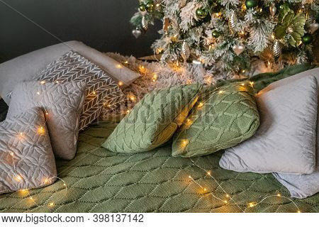 Home Cozy Interior With Garland Illuminated Cushions Scattered Near Ornate Decorated Christmas Tree