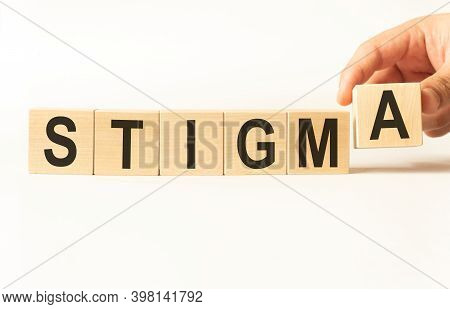 Word Stigma. Wooden Small Cubes With Letters Isolated On White Background With Copy Space Available.