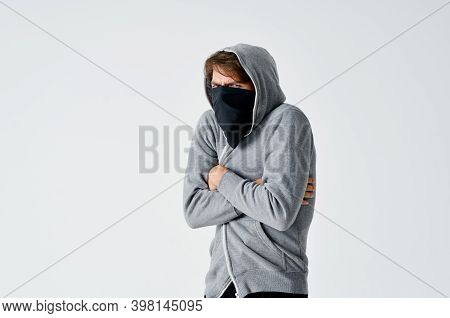 Male Hacker In A Black Mask And In A Hood On A Light Background Theft Theft