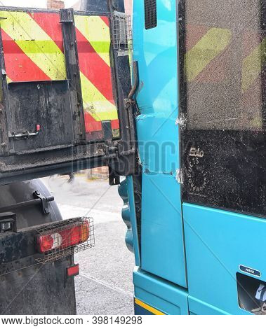 Photograph Of The Damage Caused To The Bodywork In An Accident Between A Lorry And A Bus.