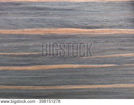 Natural Gray Fire Ebony Wood Texture Background. Veneer Surface For Interior And Exterior Manufactur