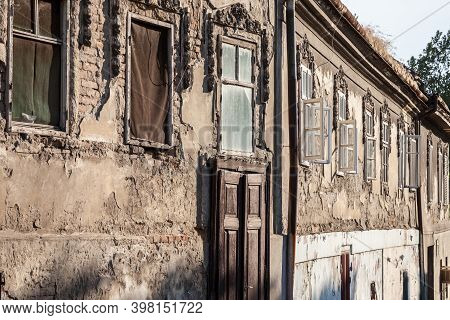 Old Windows And Abandoned Wooden Door On The Residential Building Of A Farm In Vojvodina, Serbia, Wi