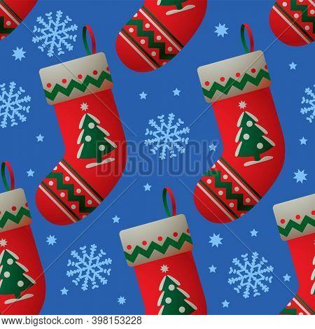 Christmas socks on blue background. Christmas seamless background.