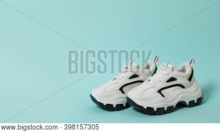 Stylish Design Sneakers With High Soles On A Blue Background. Sports Shoes With High Soles. Place Fo
