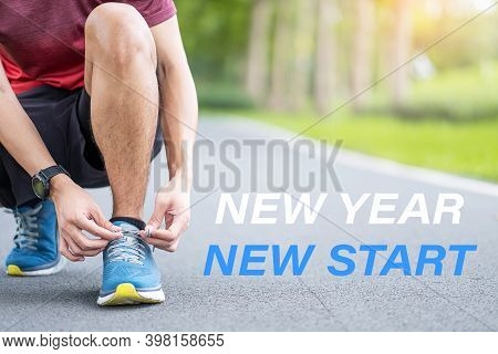 New Year New Start With Young Man Tying Shoelace In The Park Outdoor, Athlete Runner Man Ready For R