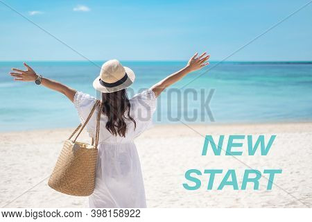 New Start With Happy Traveler Woman In White Dress And Hat Enjoy Beautiful Sea View And Tropical Bea