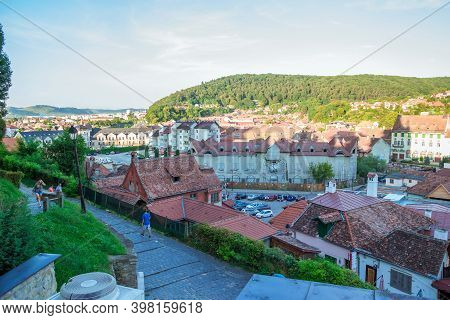 Sighisoara, Romania - August, 2019: Panoramic View Of Beautiful Colorful Houses In Sighisoara, Roman