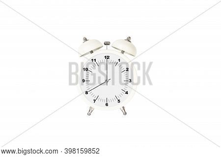 White Alarm Clock Set At Eight Isolated On White Background With Clipping Path. Close-up.