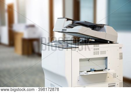 Close-up The Copier Or Xerox Printer Machine Is Office Work Tool In Copy Room For Scanning Document