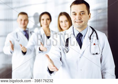 Team Of Friendly Professional Doctors Are Offering Their Helping Hand For The People. Physicians Are