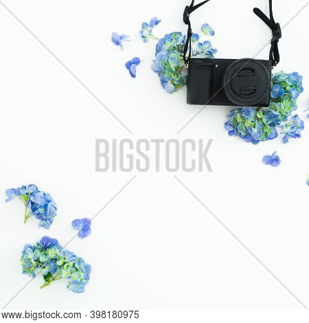 Retro Film Camera And Pink Flowers On White. Flat Lay, Top View
