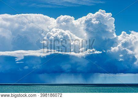 Beautiful Cumulus Clouds (cumulonimbus) On Blue Sky With Torrential Rain Over The Mediterranean Sea.